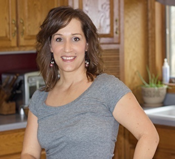 woman in gray shirt standing in kitchen