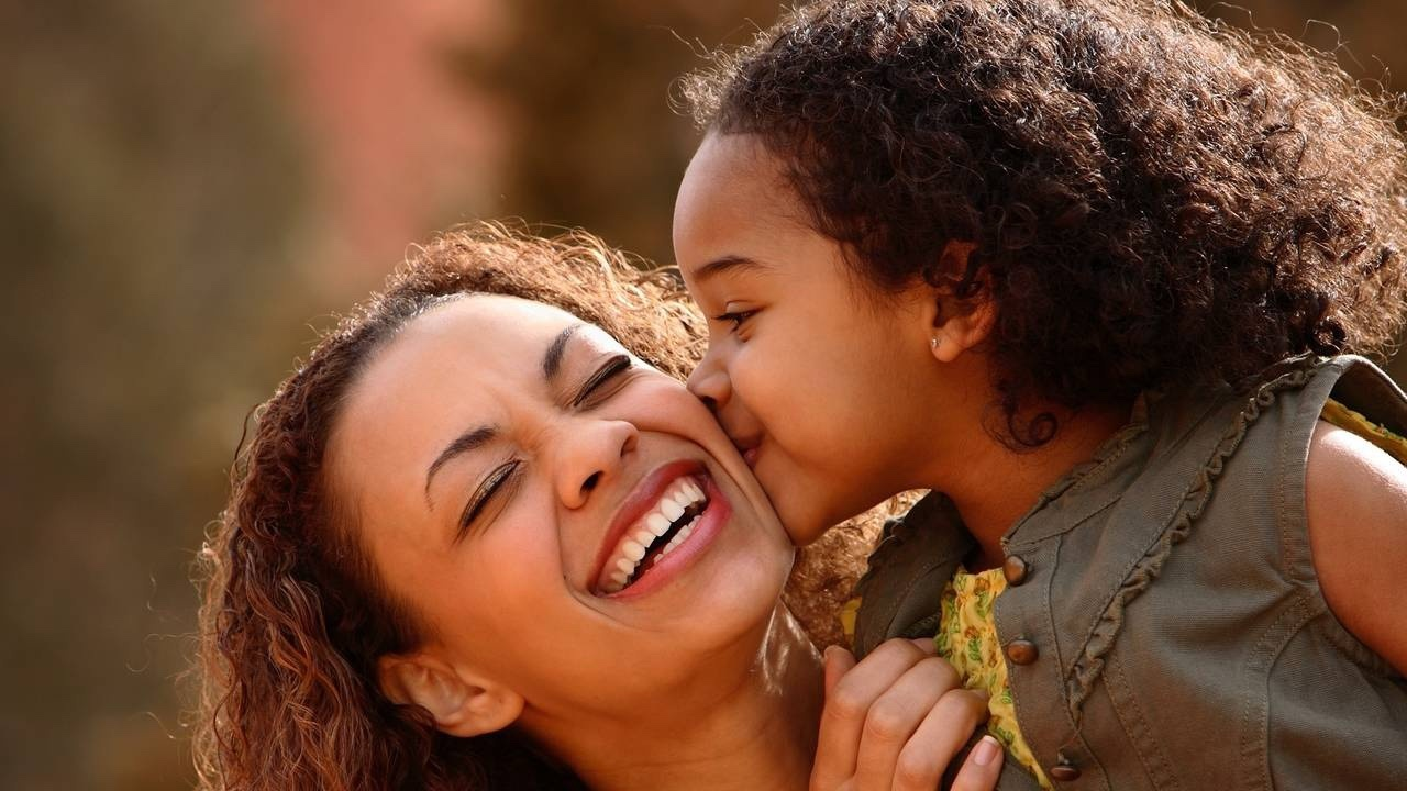 Mother smiling with child