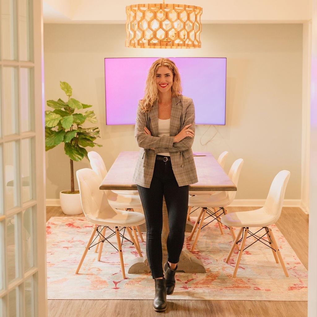 Ava Beilke standing in a board room