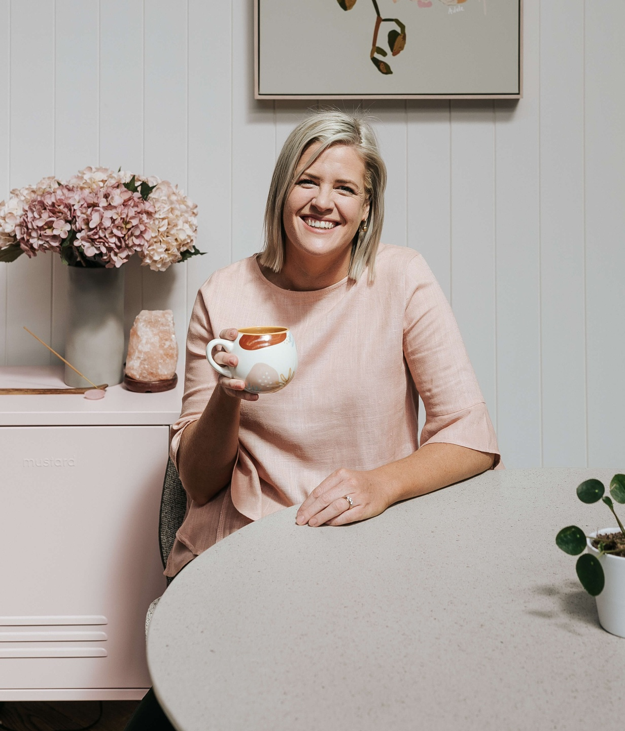 Dr Emily Amos from MORE THAN MILK smiling with a cup of tea.