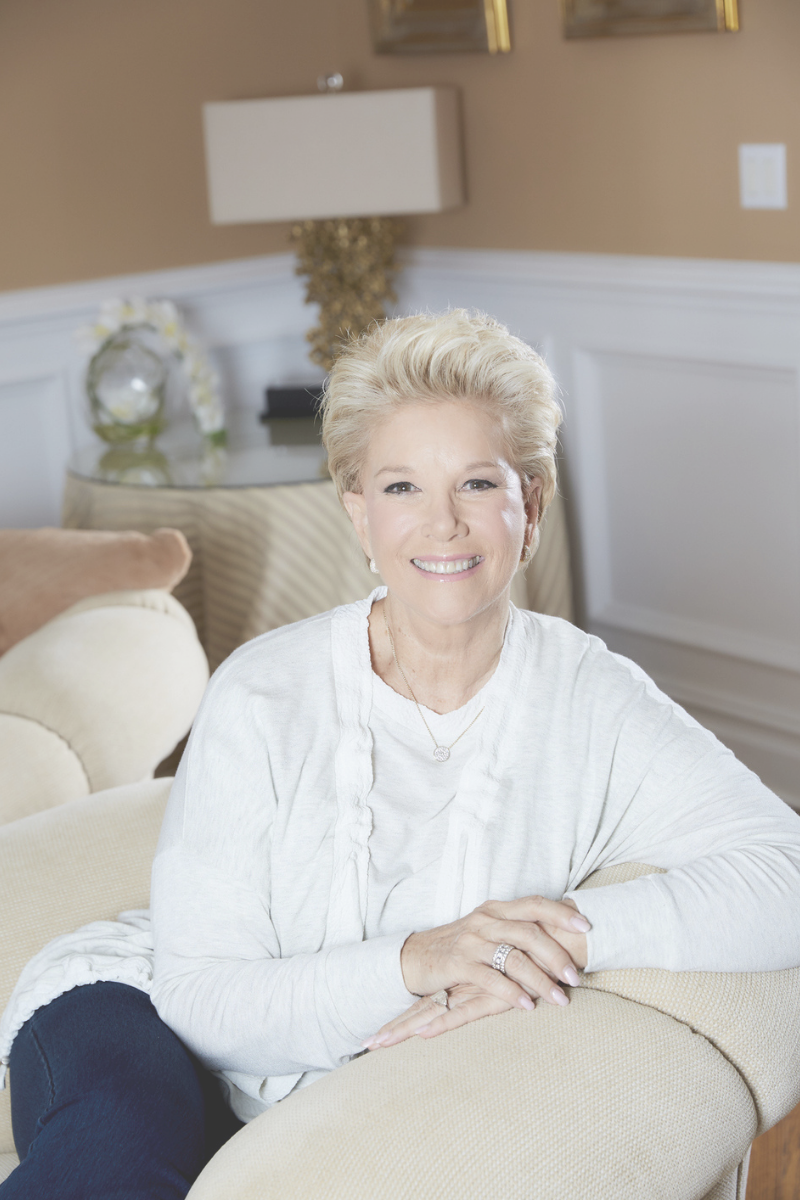 Joan Lunden sitting in a chair.