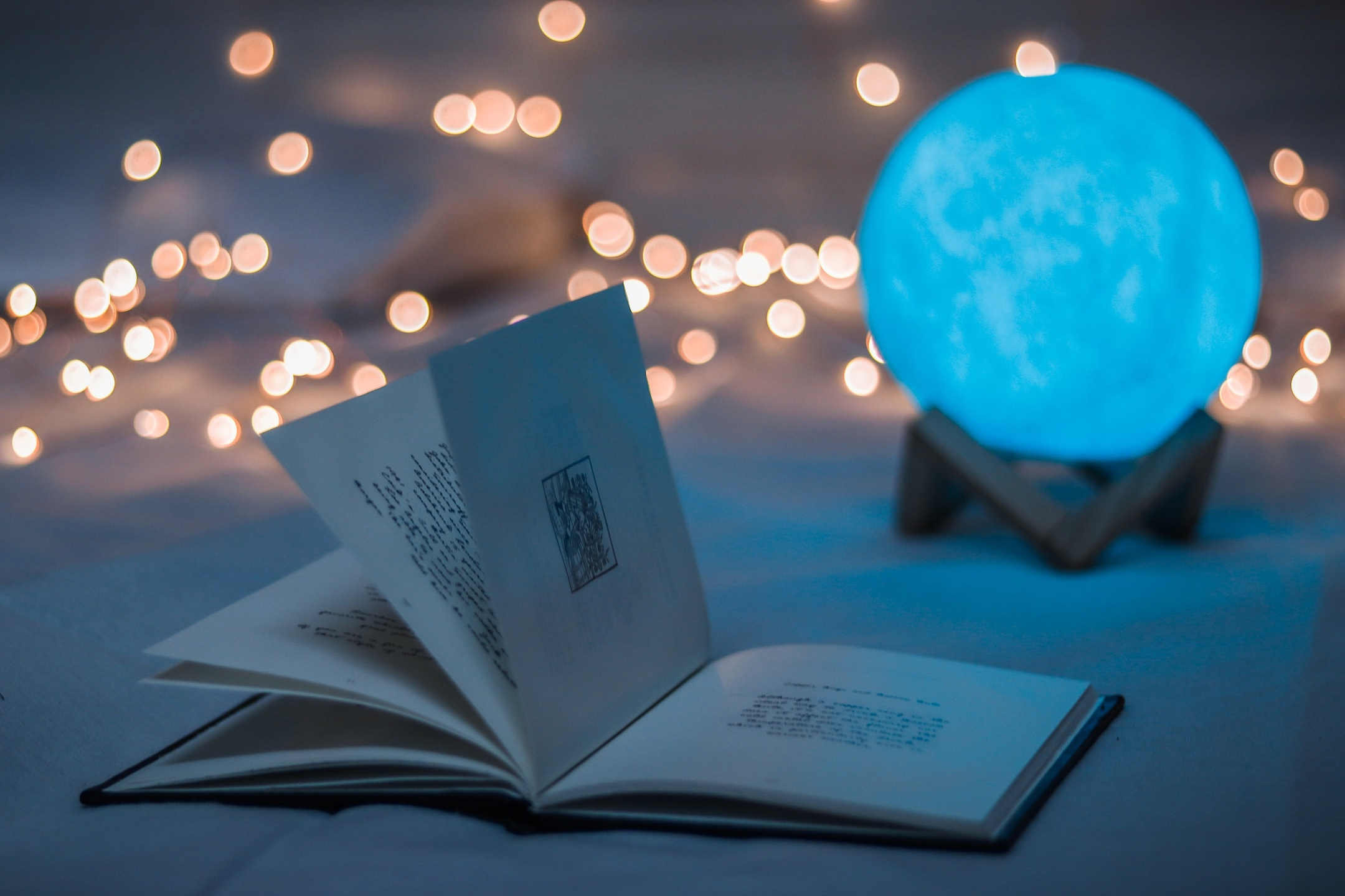 image shows oracle book and illuminated crystal ball