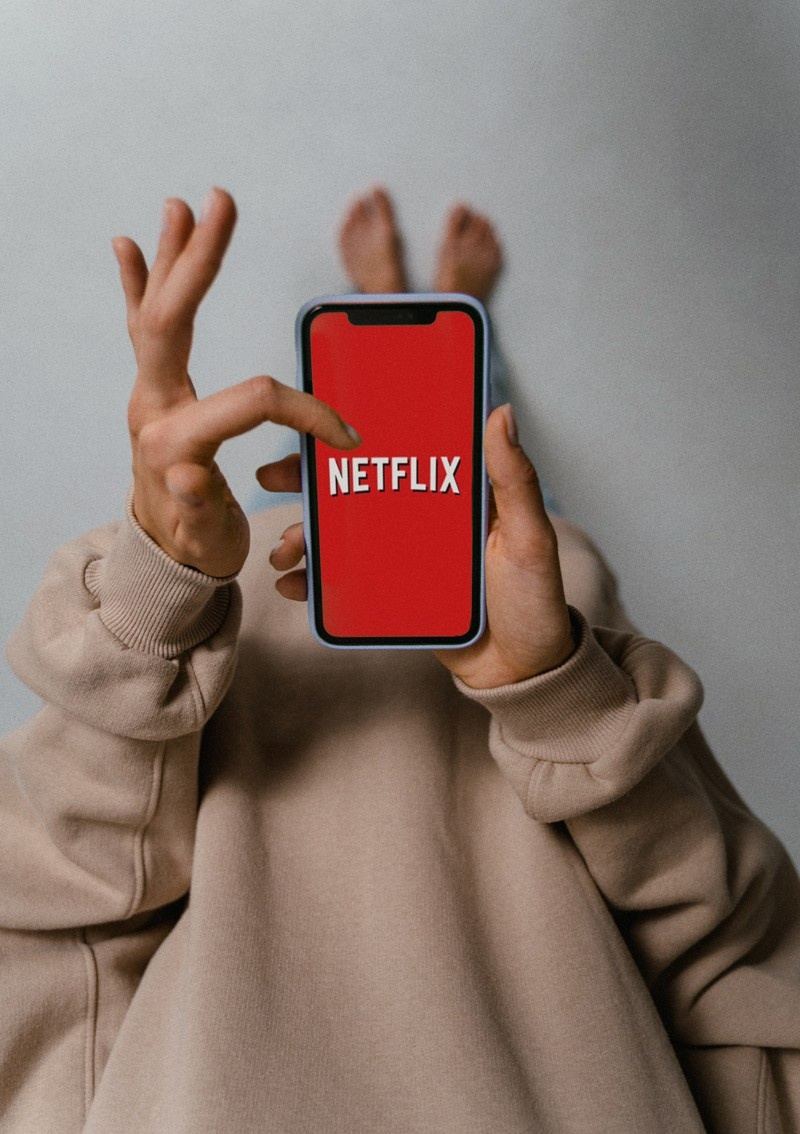 Person watching Netflix on their phone