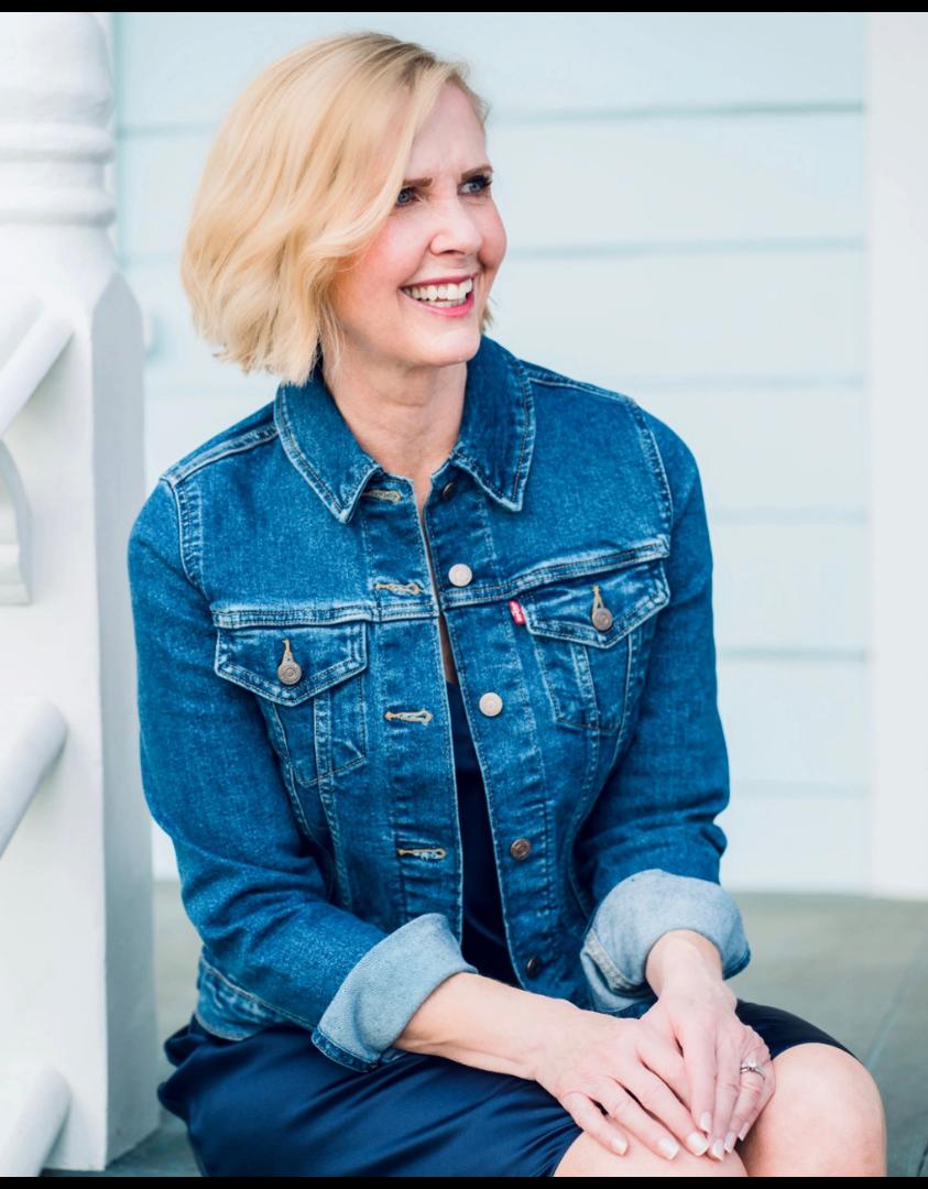 Blonde woman in levi denim jacket smiling