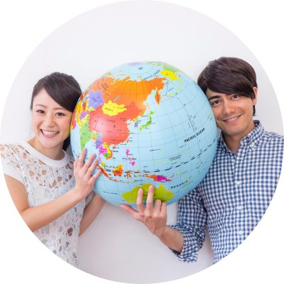 Asian looking woman and man with a globe between them