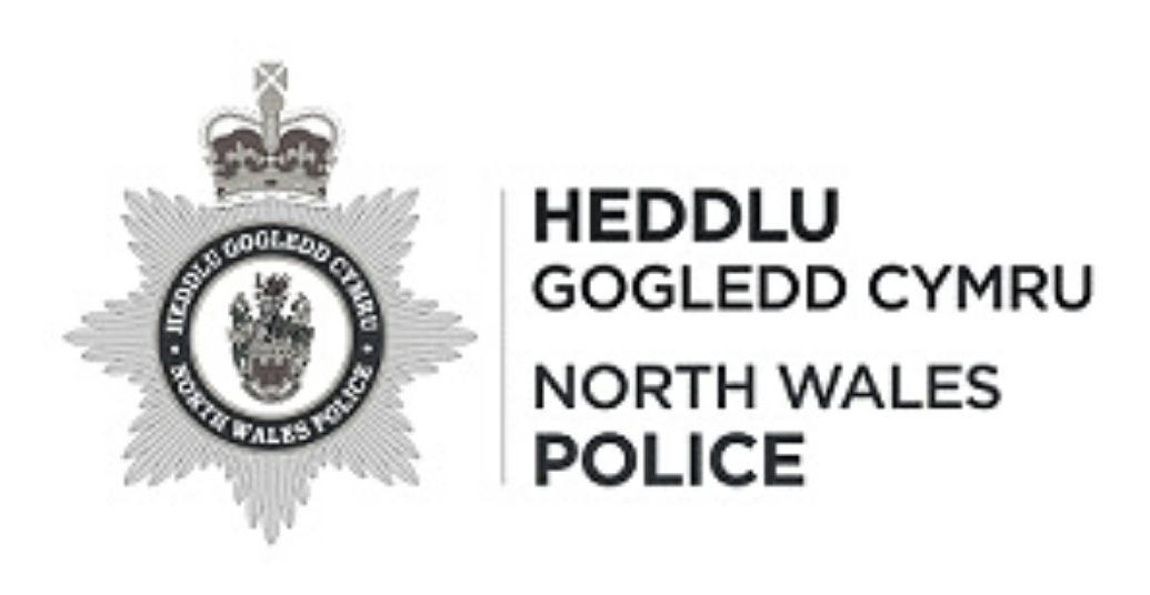 North Wales Police logo in dark grey links to North Wales Police website