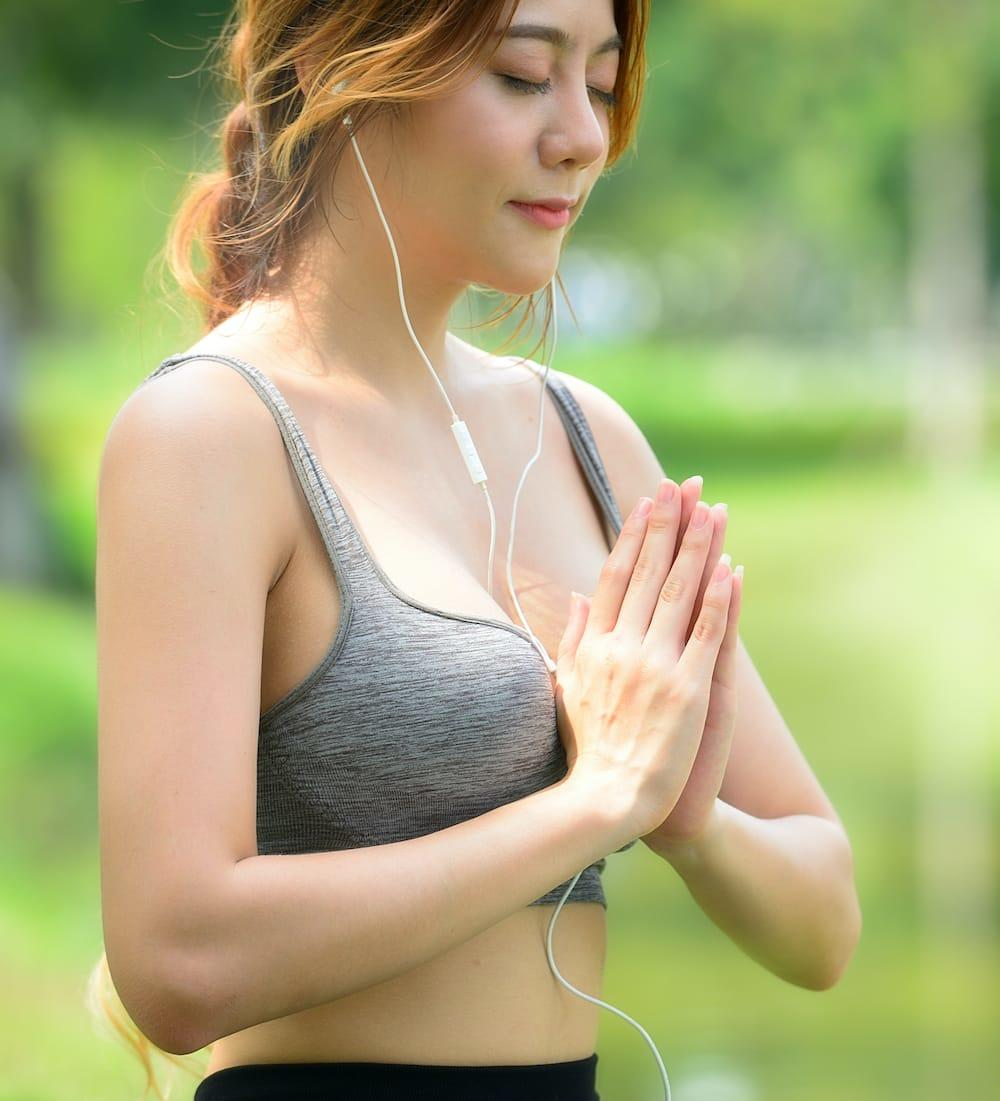 Woman with hands in prayer pose