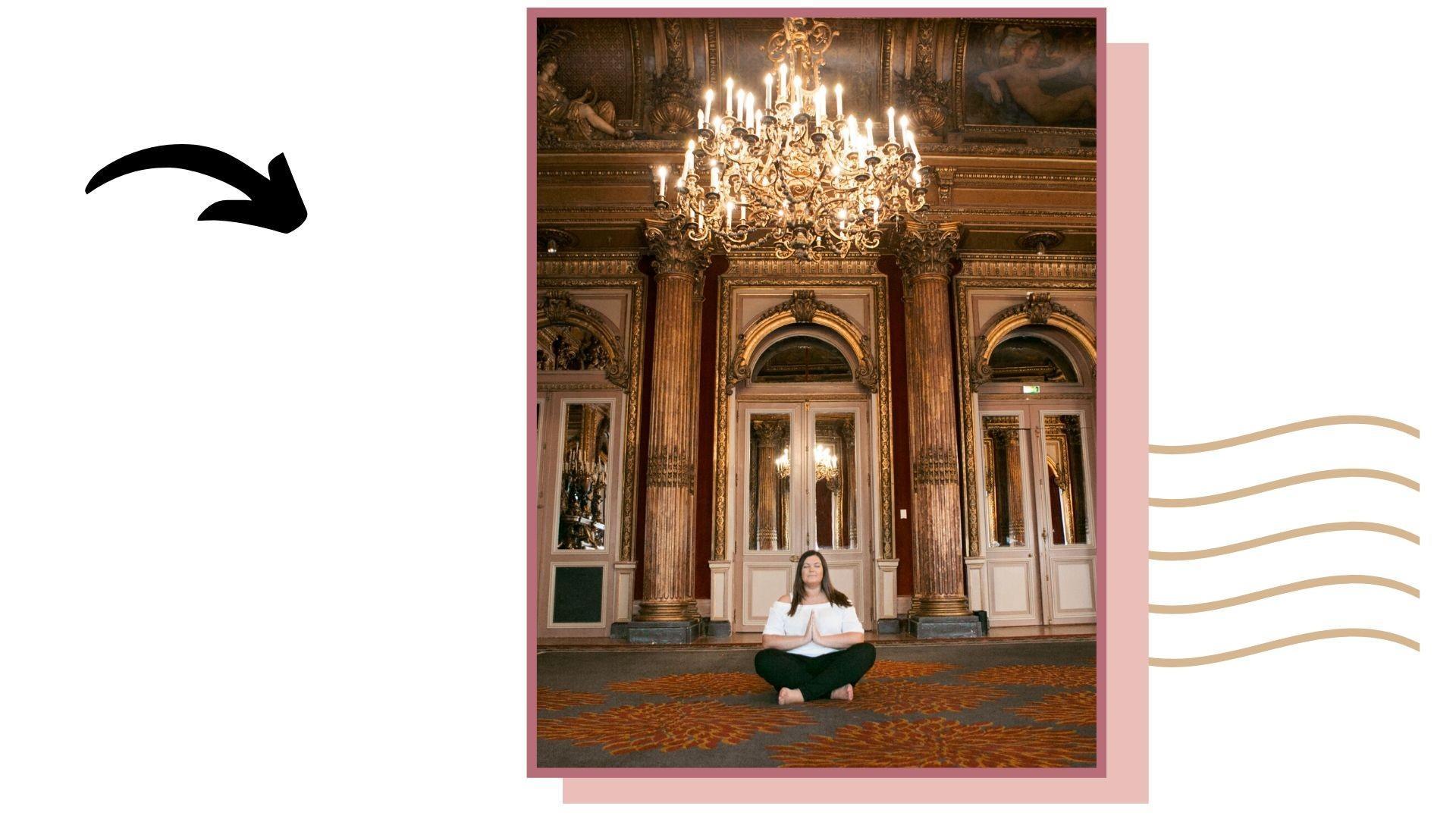 Jennifer Grace sat meditating under chandelier