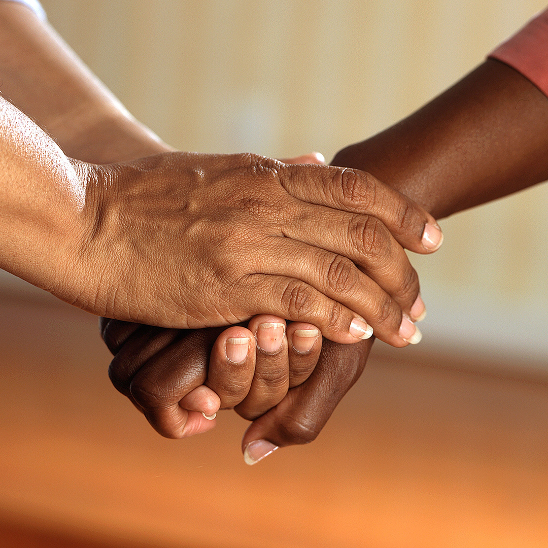 Natural Cancer Care Support Services in Port Credit Mississauga, ON - pureBalance Wellness Cancer Care - pair of hands holding another person's hand