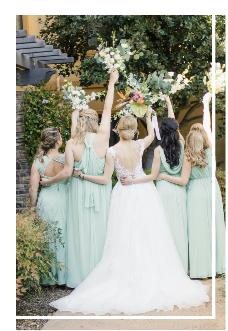 Bride and bridesmaids with sage dresses holding flowers