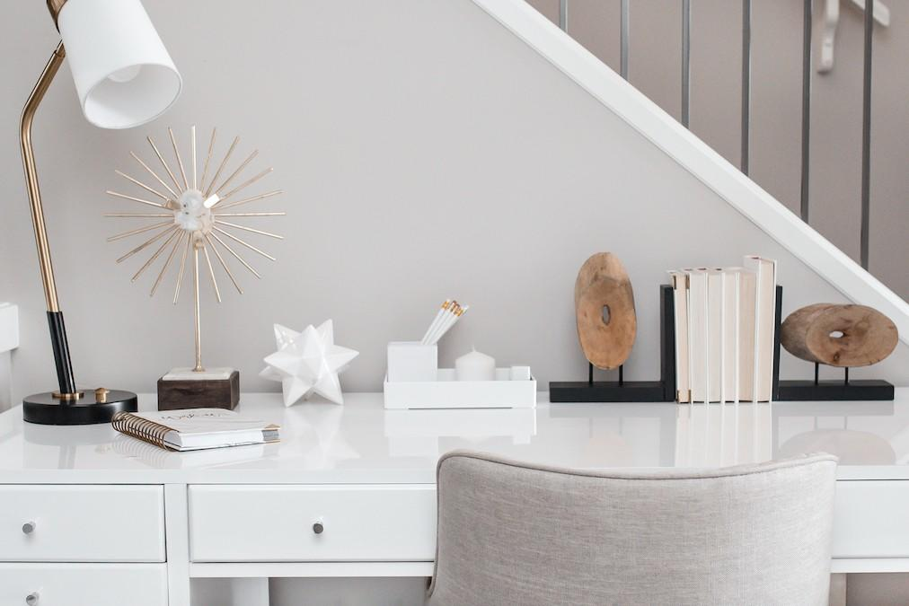 white desk with gray chair