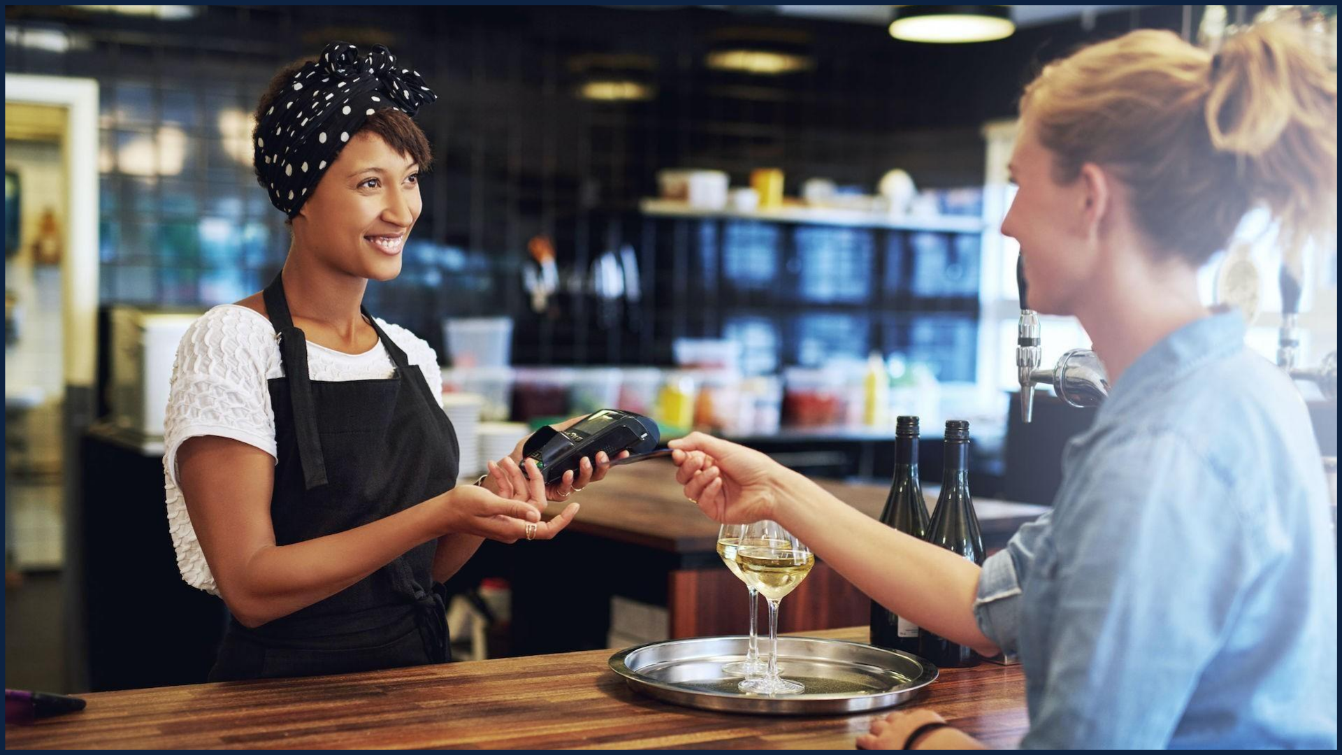 Customer paying with card at the cashier
