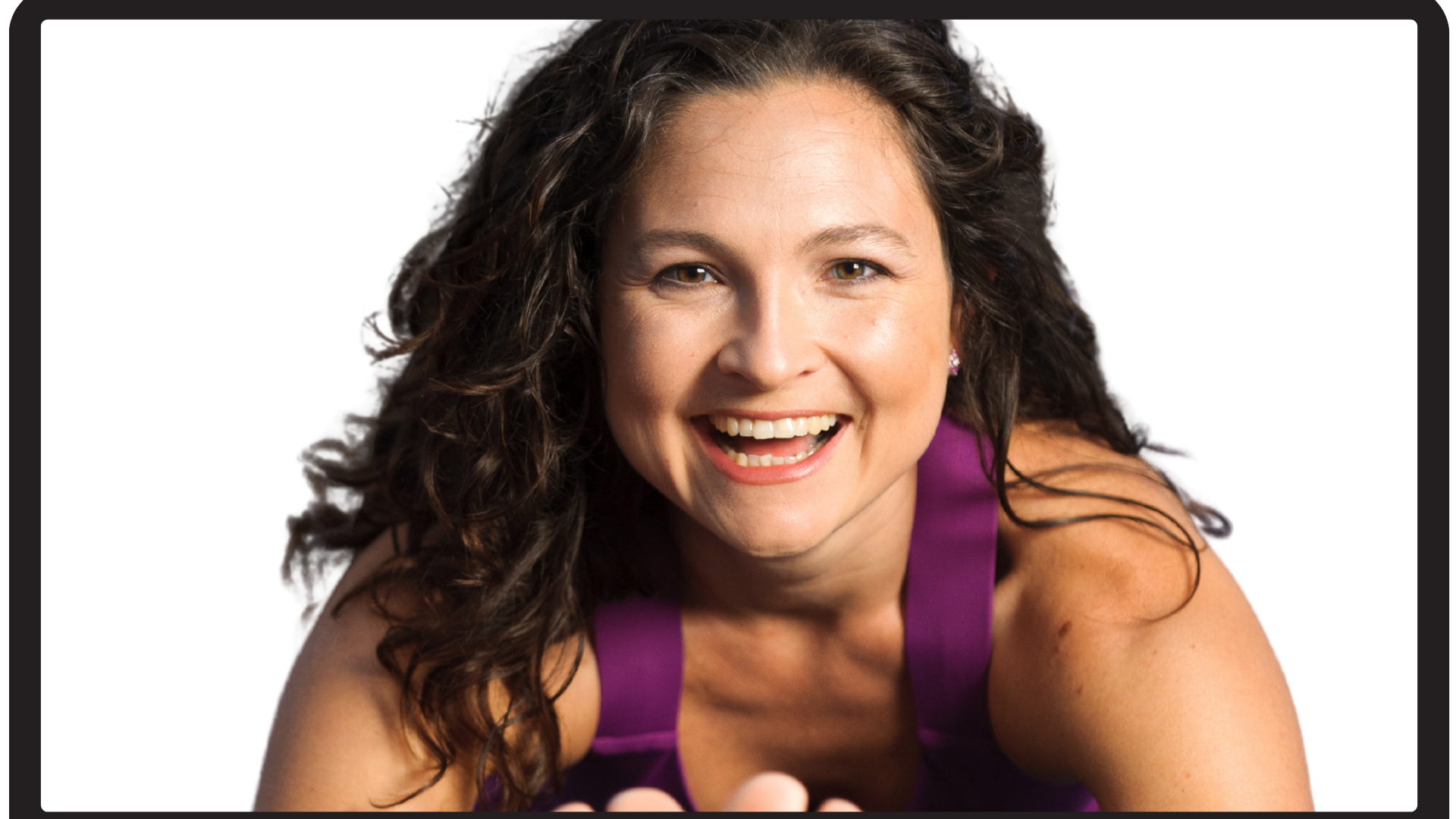 Picture of a woman smiling while doing Pilates