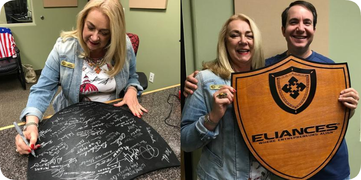 Eliances Heroes Podcast Isabel signing plaque
