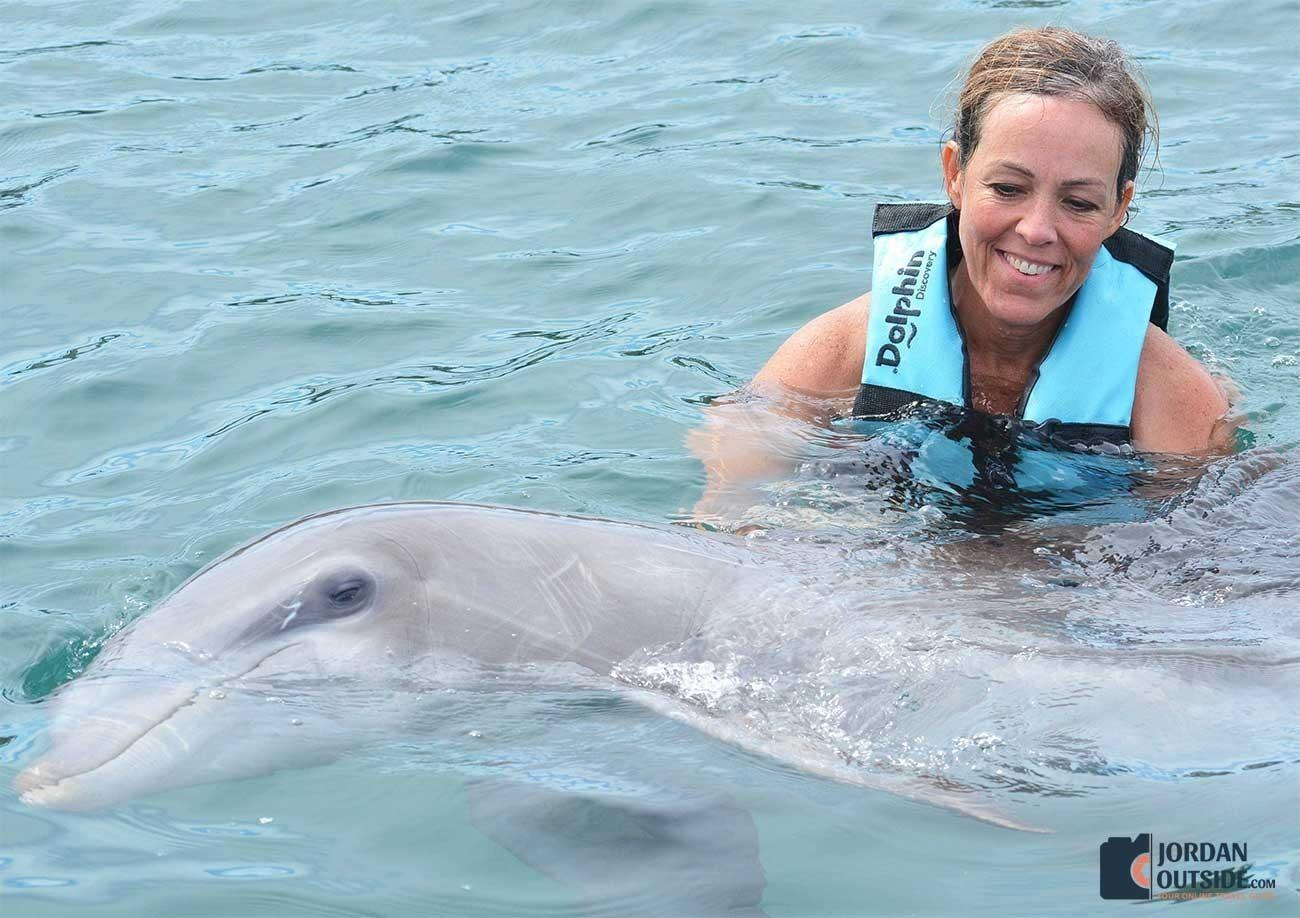 Julie holding a dolphin