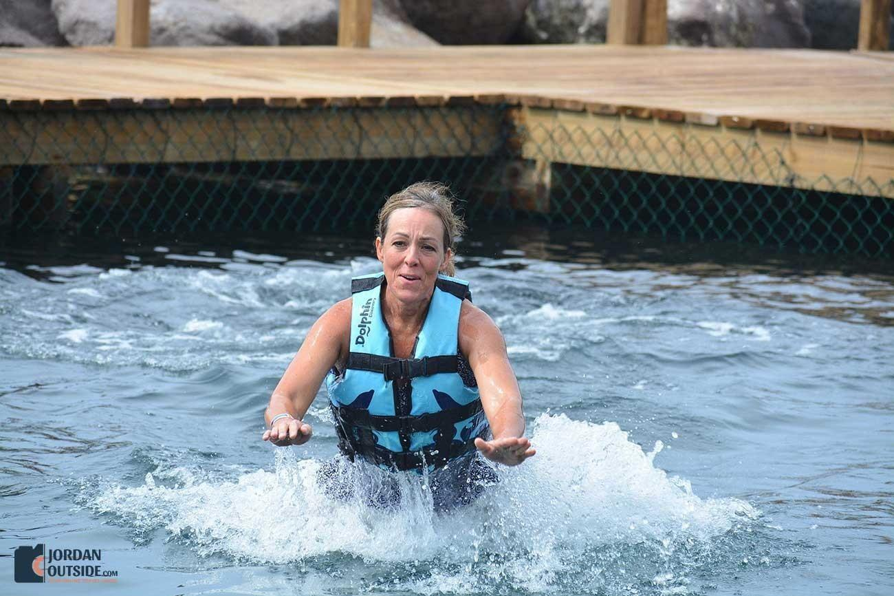 Julie being pushed by Dolphins