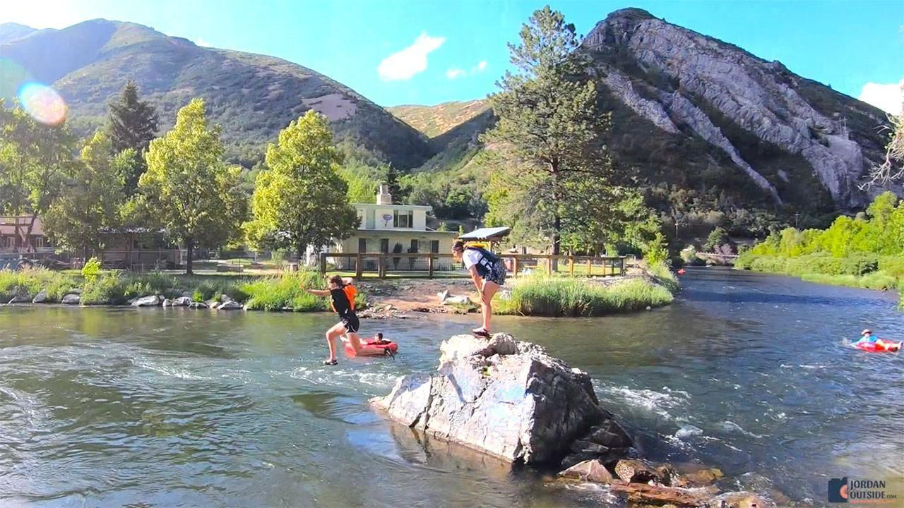 Tarin jumping off a rock in the Provo River