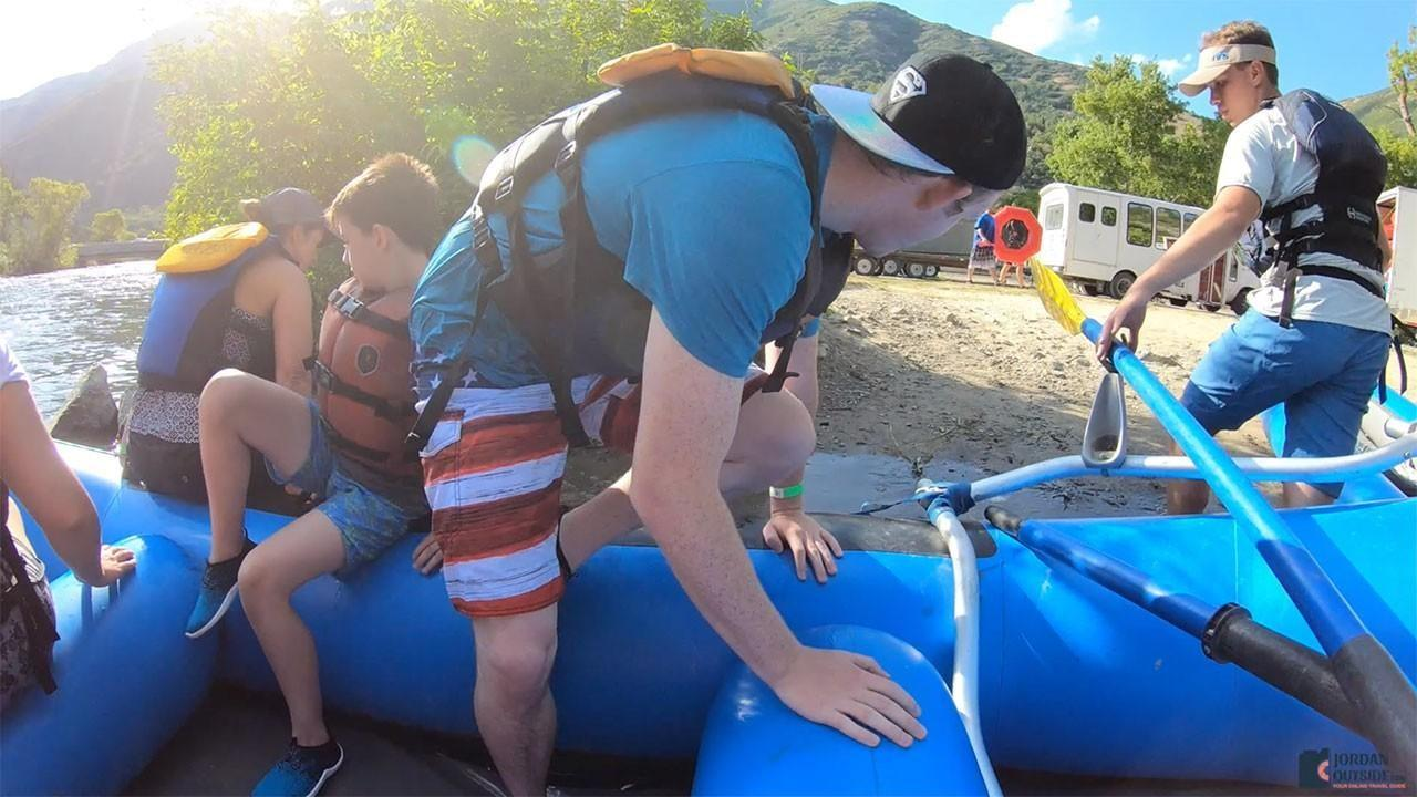 Getting out of our raft on the Provo River