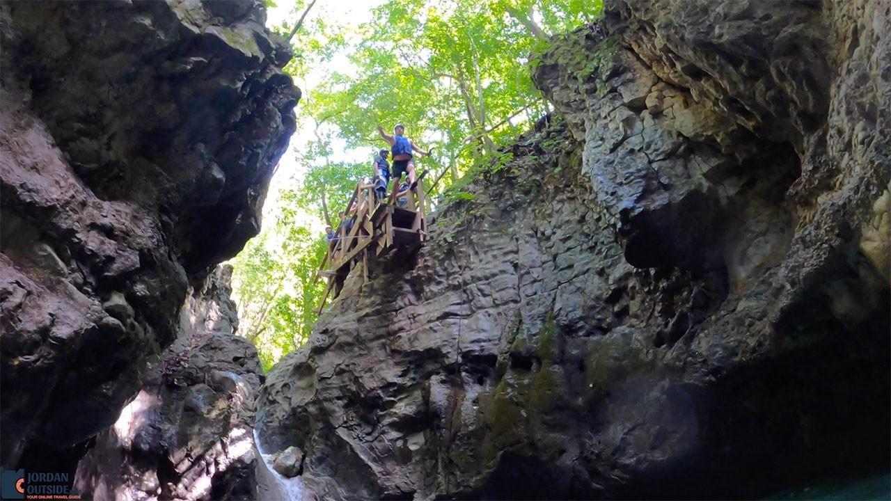 Jordan jumping off a 25 foot jump at Damajagua Waterfalls