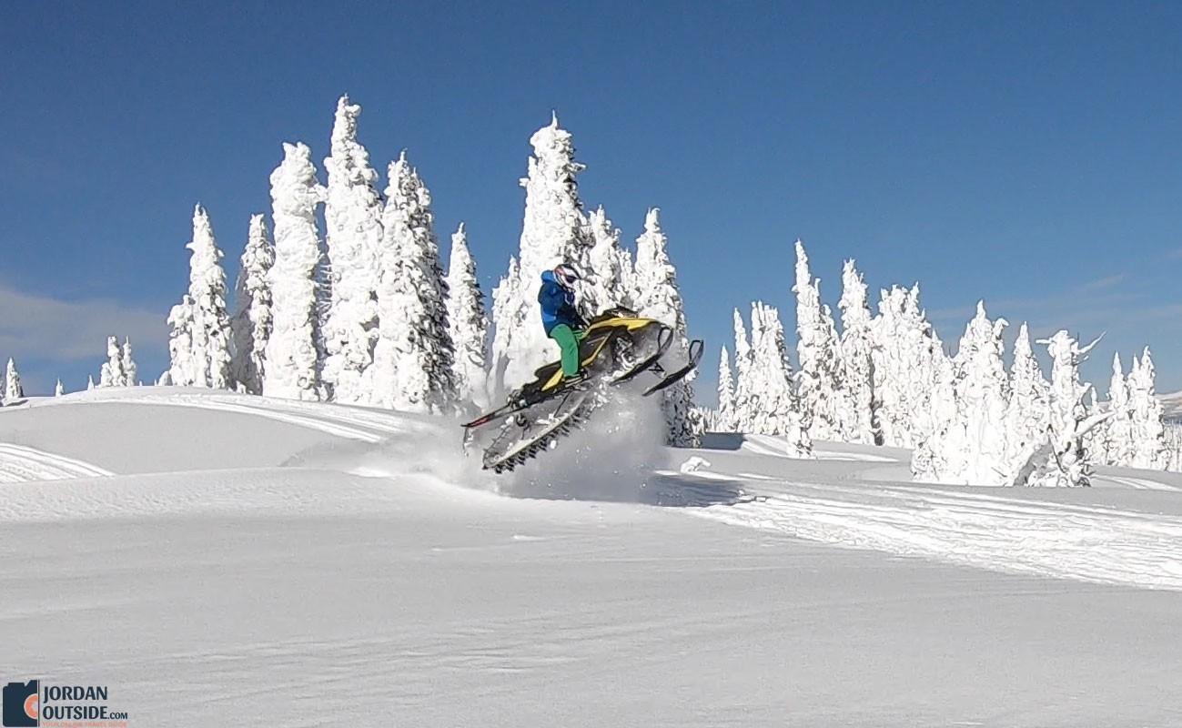 Gary taking a jump on his snowmobile