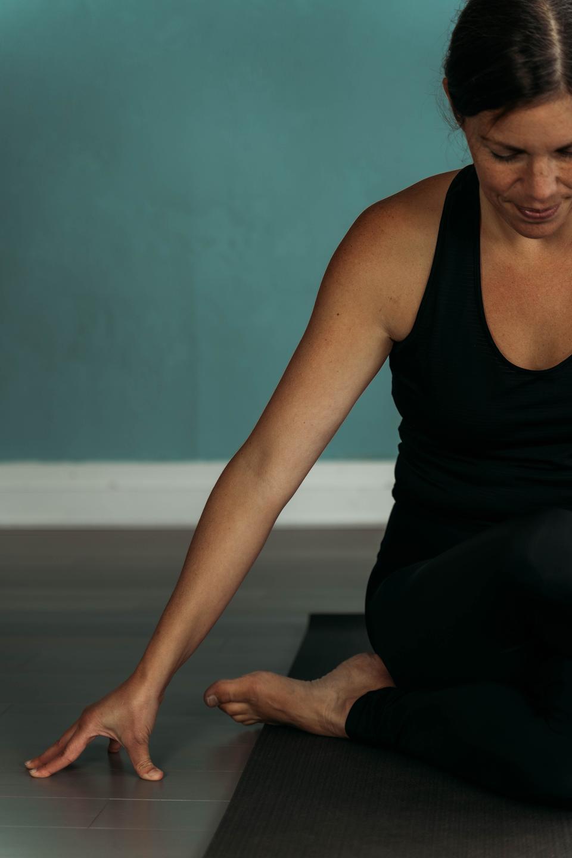 woman doing cowface yoga pose