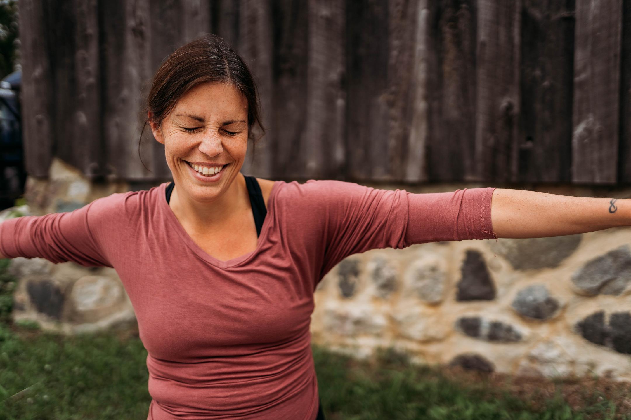 Rankin smiling in warrior II Yoga Pose