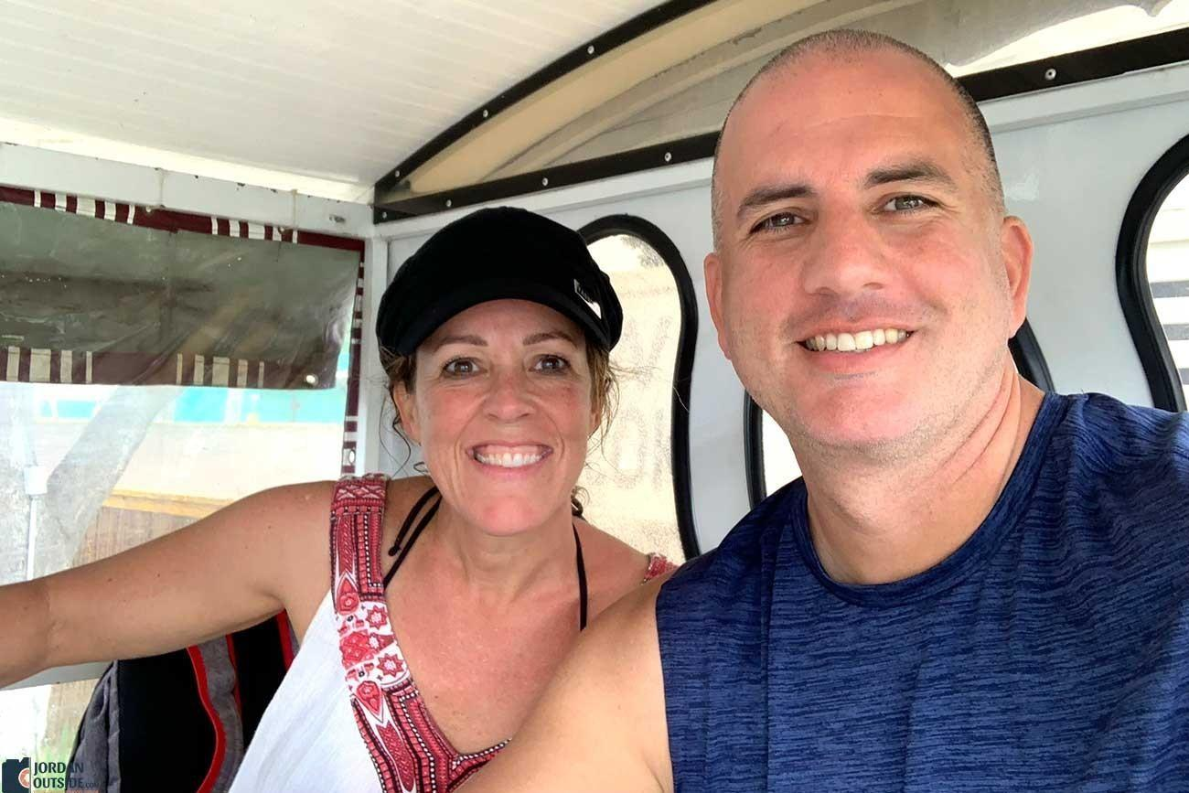 Julie and Jordan in an open air taxi