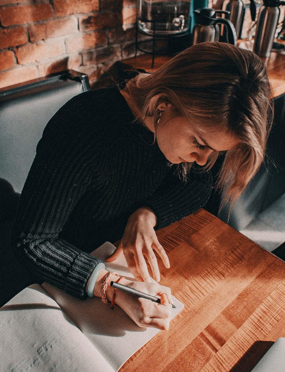 Woman writing a book