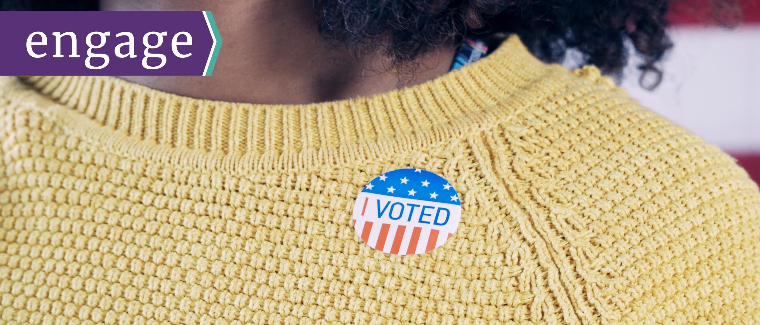 I voted sticker on a woman's sweater
