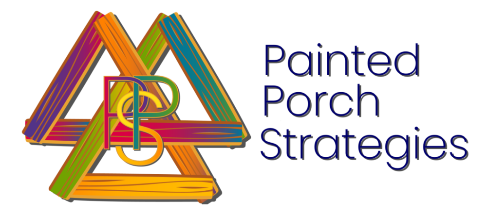 Three triangles of colorfully-painted wood intersecting