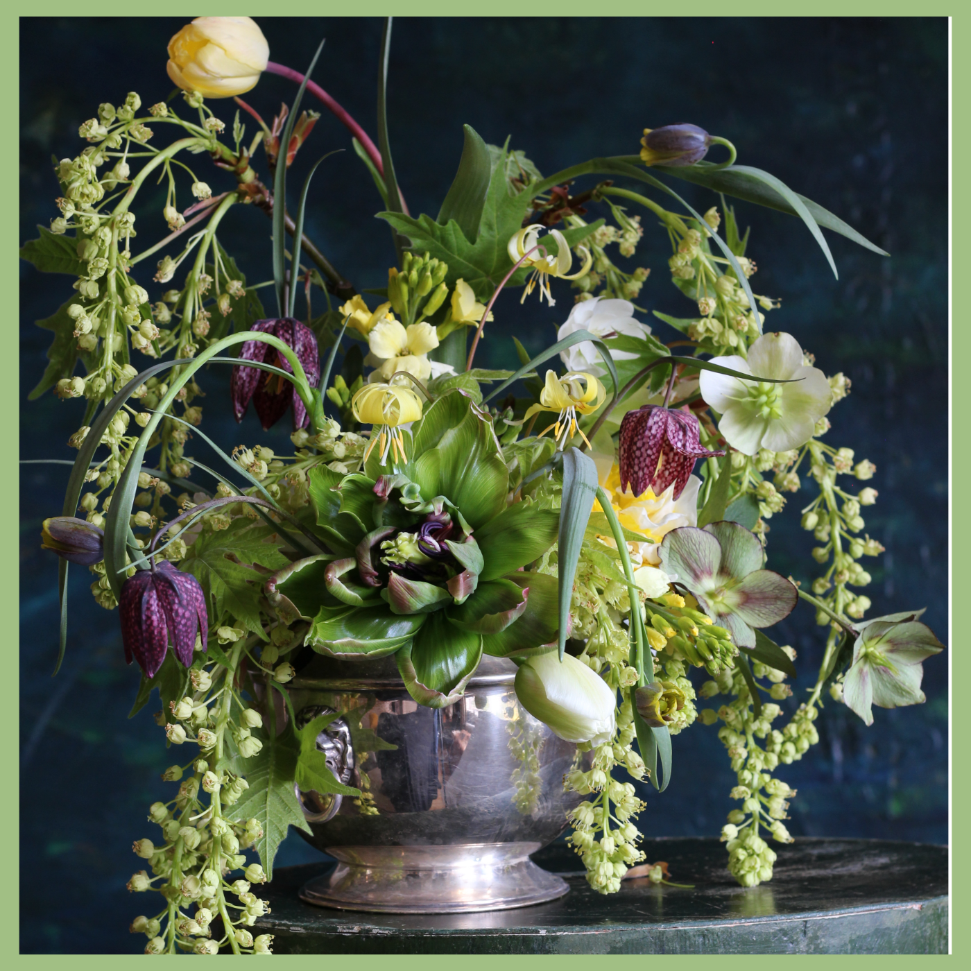 Floral arrangement with spring green and purple flowers