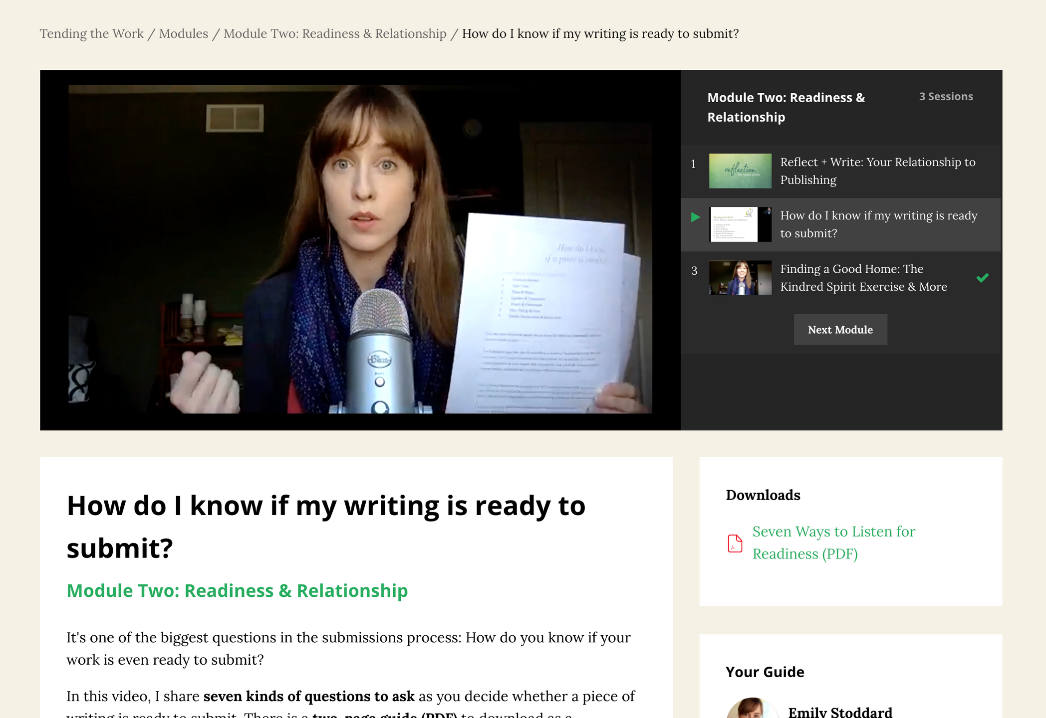 Image of private workshop area, with Emily at a microphone holding a piece of paper and talking about how to know if your writing is ready to submit