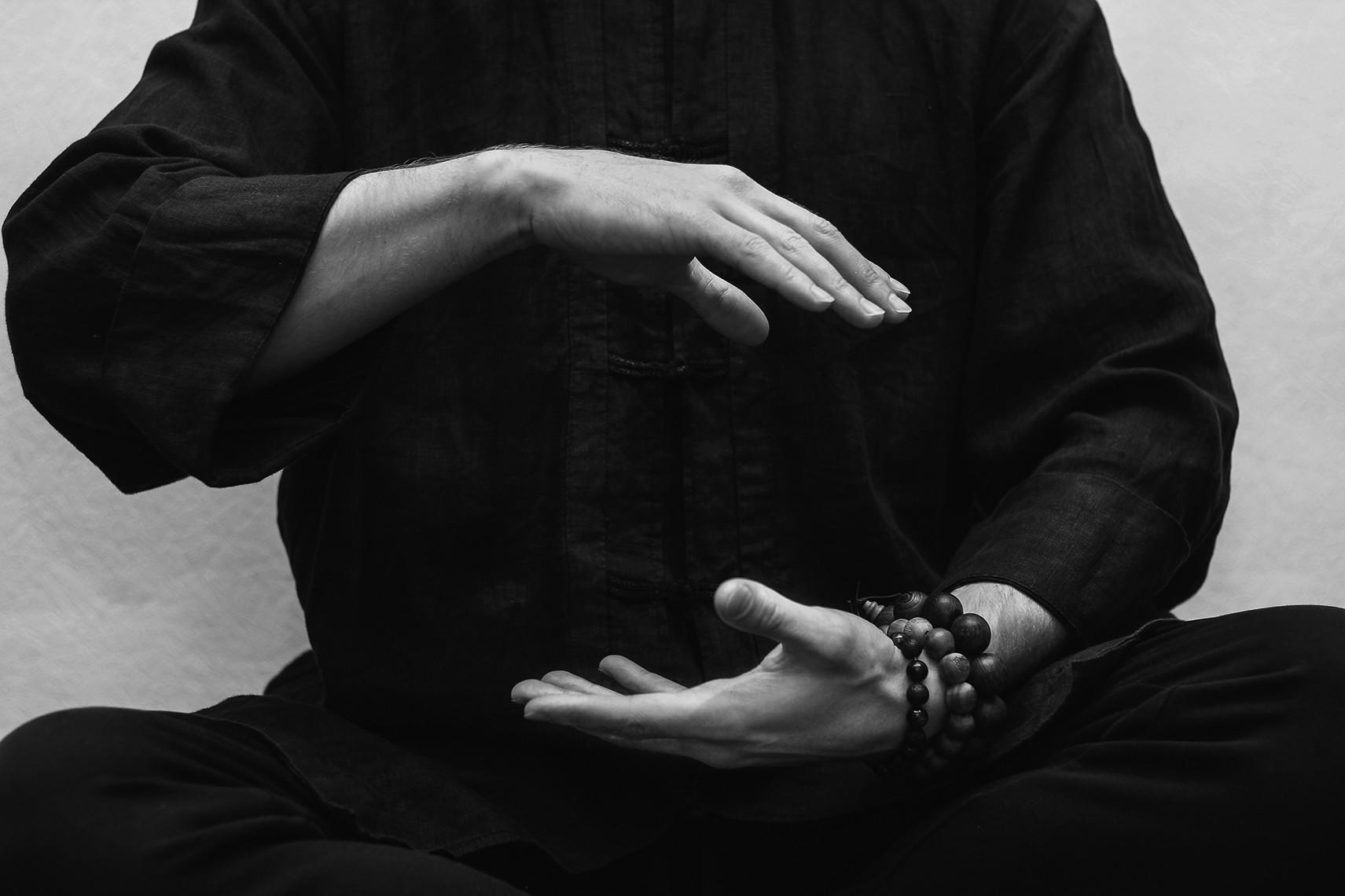 seated man practices Qi Gong