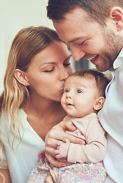 Husband and Wife with baby Daughter
