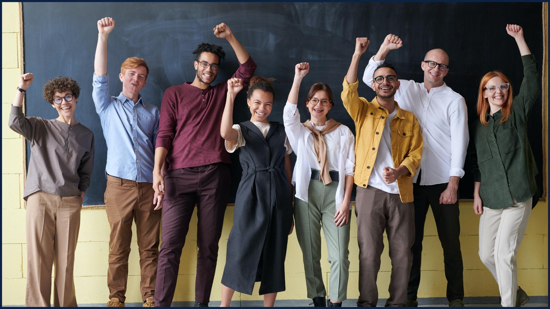Group of People Standing in front of Blackboard