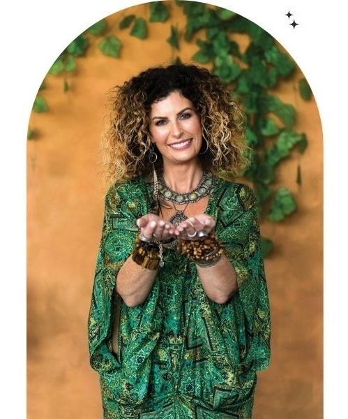 Spiritual healing with Alana Fairchild Image in green dress reaching towards you