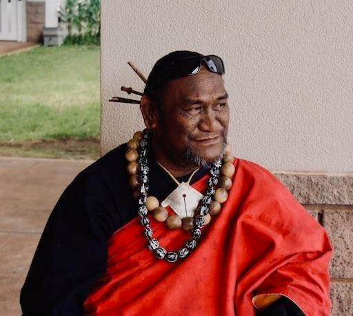 Kumu Paʻa Lawrence Aki in red kīkepa