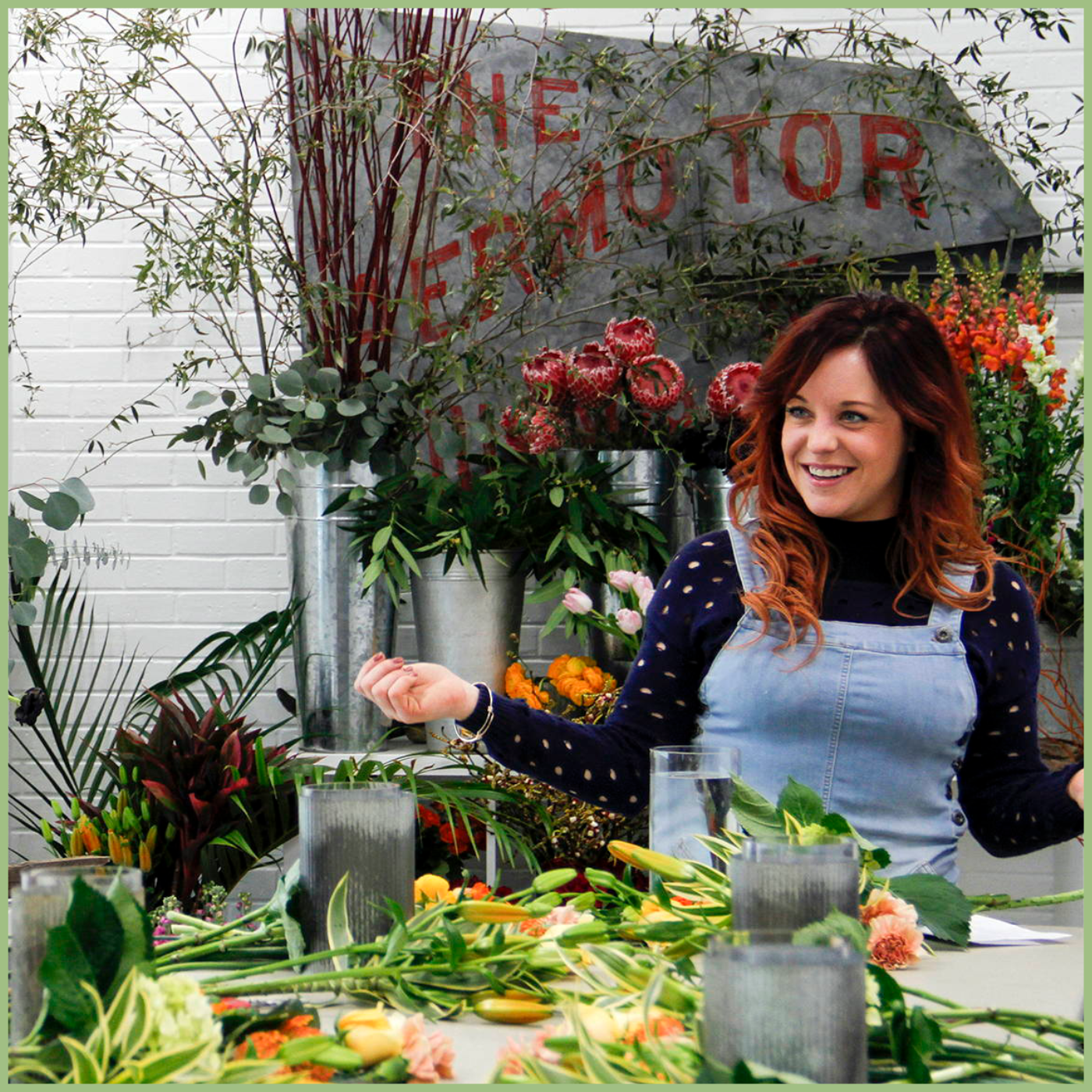 Jenny Thomasson smiling while teaching floral design