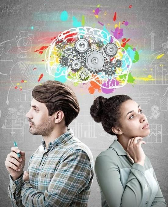 White man and light-skinned black woman standing back to back in thought with a colourful painted brain filled with gears floating above