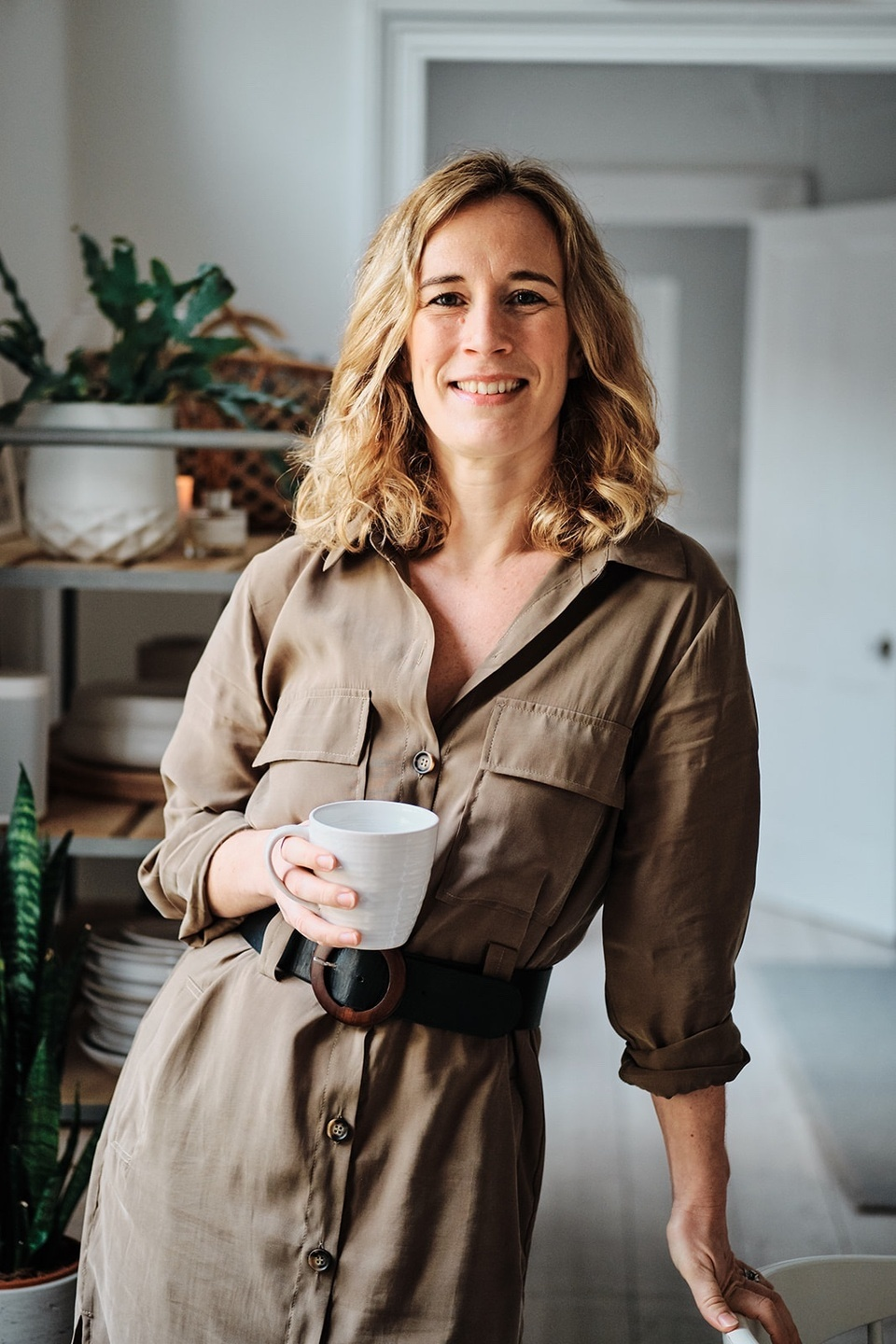 Picture of Zoe Hawkins smiling holding a mug