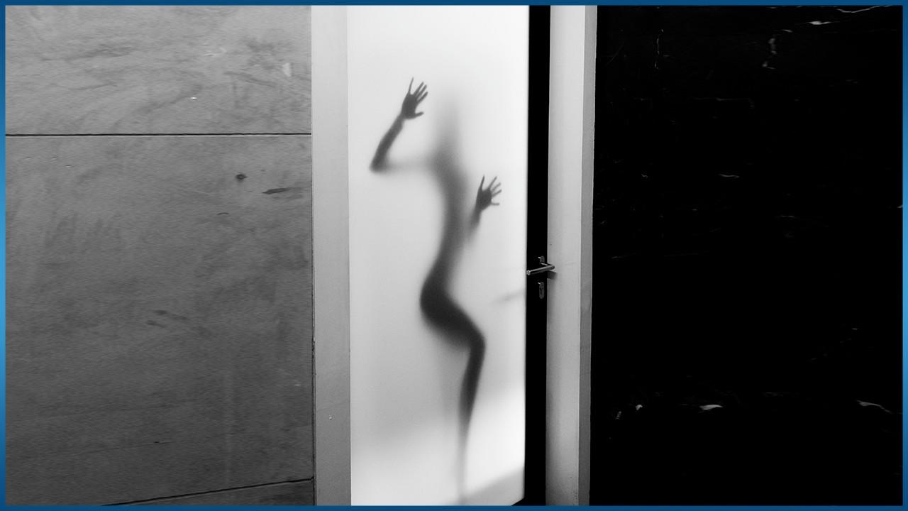 person standing behind opaque window