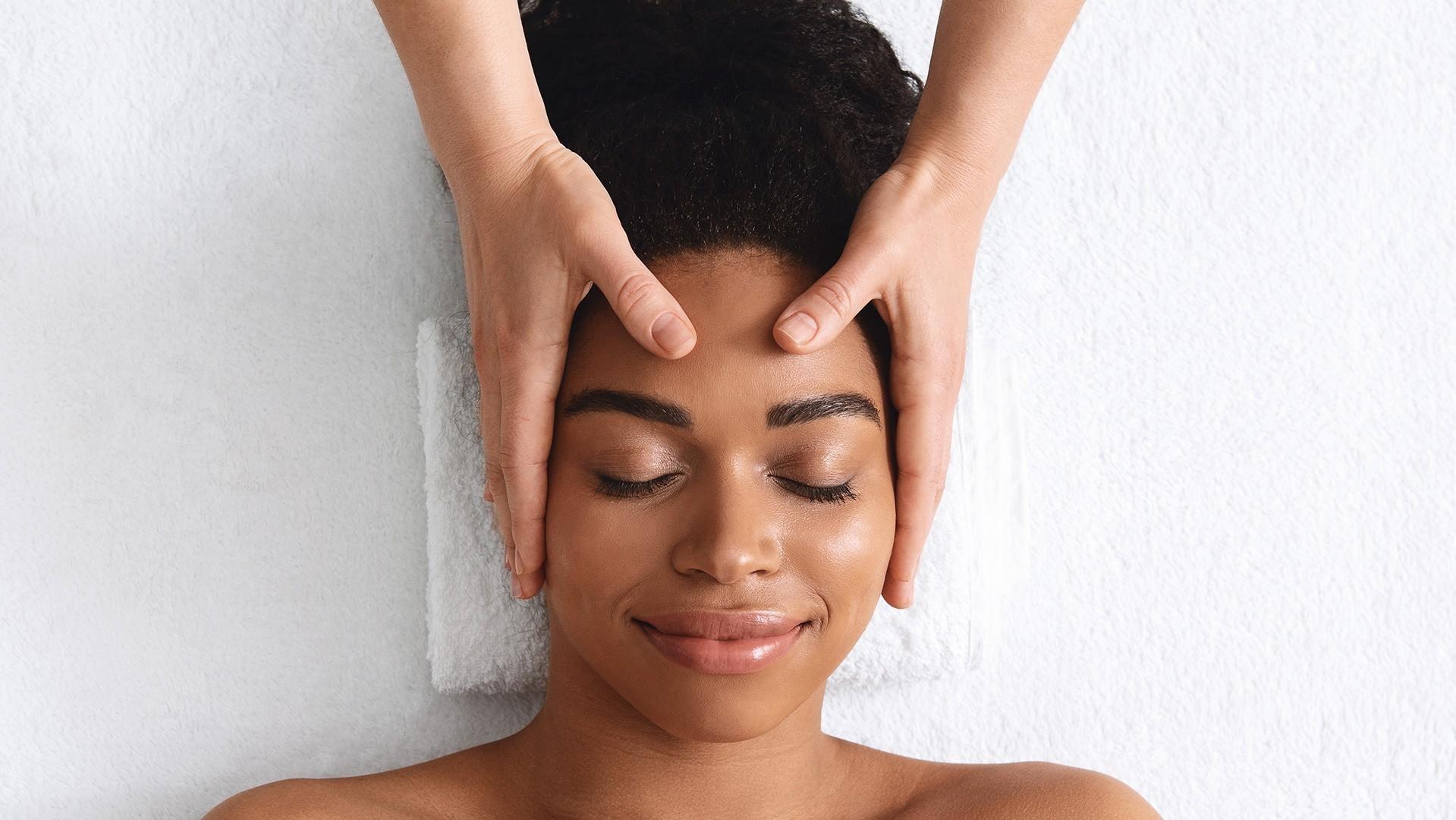 african american woman getting a head massage - Indian Head Massage offered at pureBalance Wellness