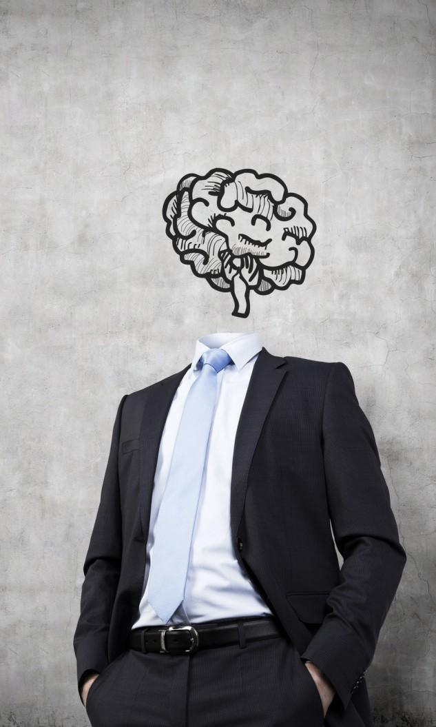 Business man without head and a drawing of a brain instead
