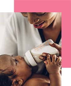 Mother bottle feeding baby