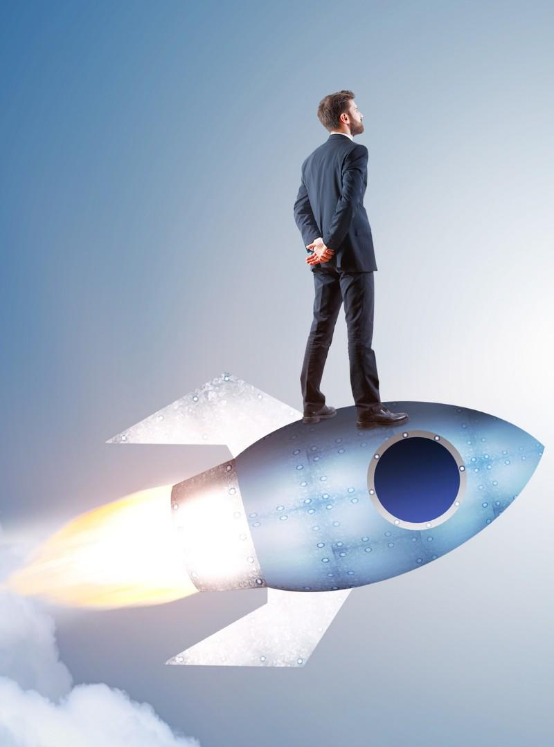 businessman standing on a rocket