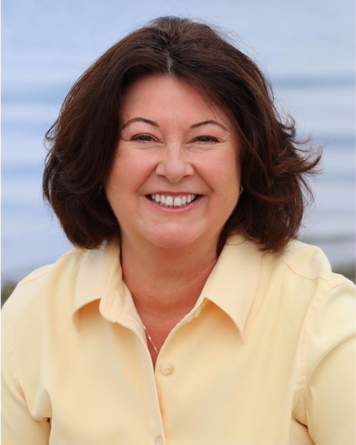 Maria Furlano headshot yellow shirt The Art Of Tuning In Healers