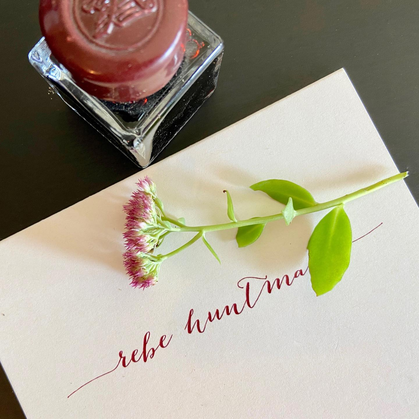 Writer Rebe Huntman's calligrapy stationery with magenta ink bottle