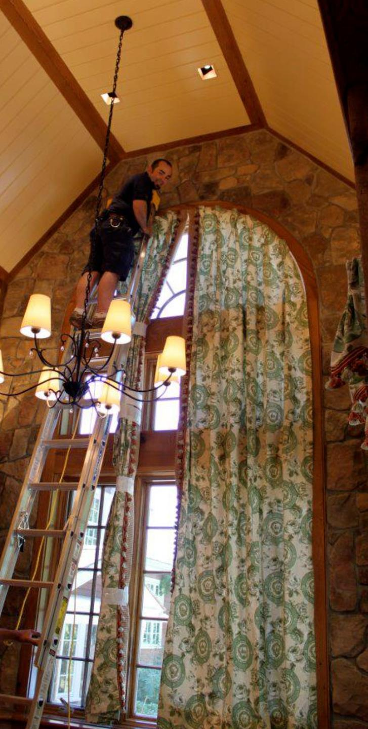 roger installing window curtains