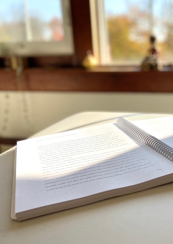 open memoir book manuscript in Rebe Huntman's writing studio