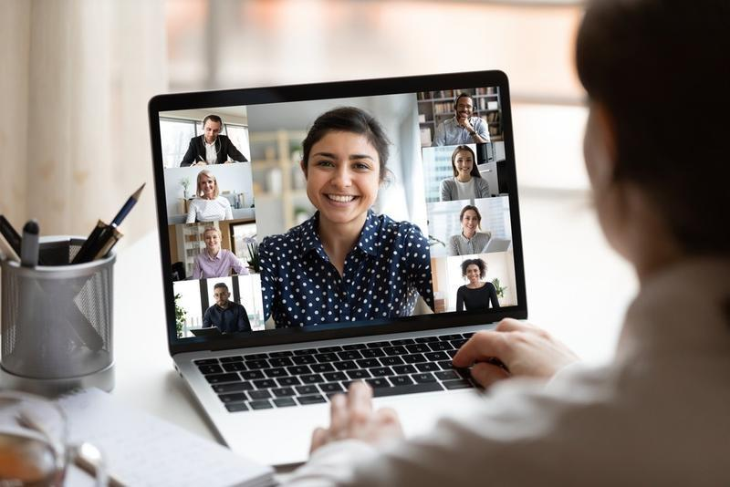 photo of woman speaking on a video conference